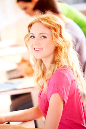 Beautiful blond girl working on laptop computer Stock Photo - 12557091