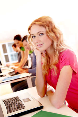 Beautiful blond girl working on laptop computer Stock Photo - 12557151