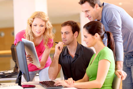 team management: Group of smiling young people in training course Stock Photo