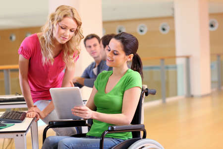 Handicapped person at work with electronic tablet Stock Photo
