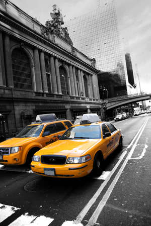 taxicabs: Yellowcabs waiting at stoplights near NEw York Central train station