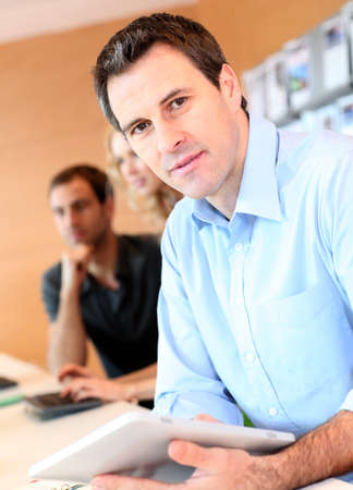 Portrait of office worker with tablet Stock Photo - 12557043