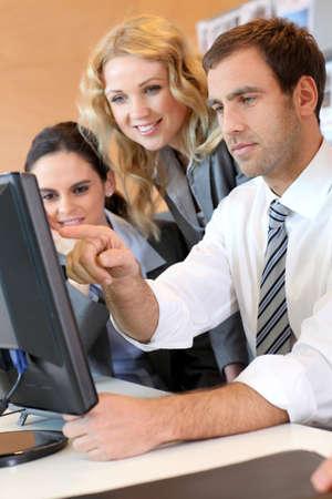sales meeting: Business meeting in front of desktop computer