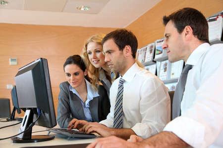 desktop computer: Business meeting in front of desktop computer