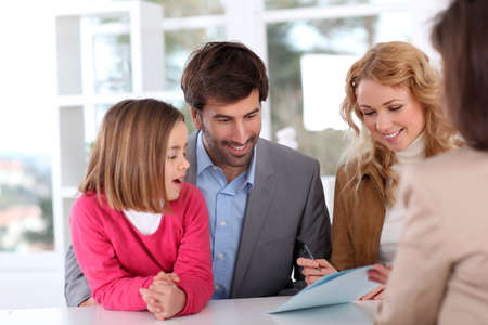 signing: Family signing real-estate contract Stock Photo
