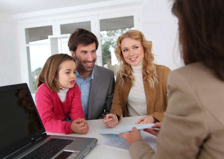 signing a contract: Family signing real-estate contract Stock Photo