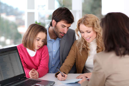 Family signing real-estate contract Stock Photo
