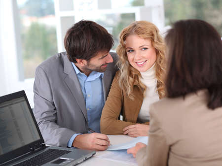 Couple signing property contract Stock Photo - 12557049