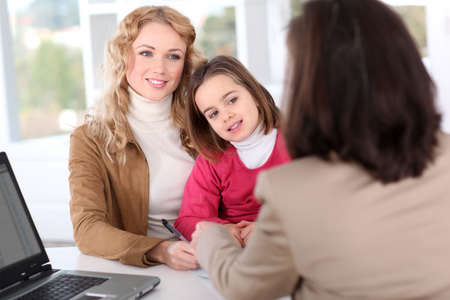 Woman in real-estate agency with kid Stock Photo - 12557031