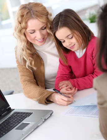 purchaser: Woman in real-estate agency with kid Stock Photo