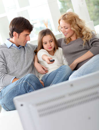 Family watching movie on television photo