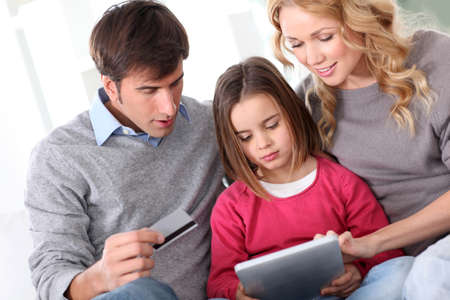 Family doing online shopping with tablet Stock Photo - 12556980