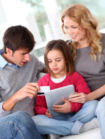 Family doing online shopping with tablet photo