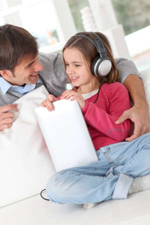 Father and daughter listening to music photo