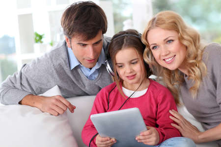 Family listening to music with tablet photo