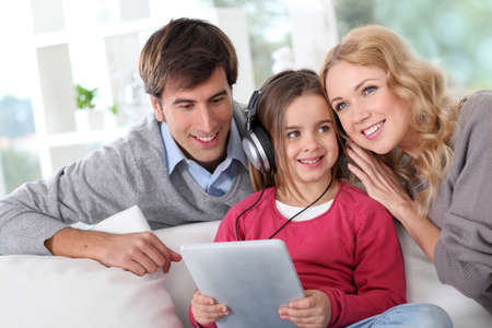 Family listening to music with tablet