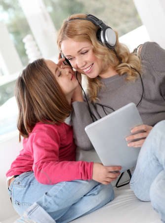 Mother and daughter listening to music photo