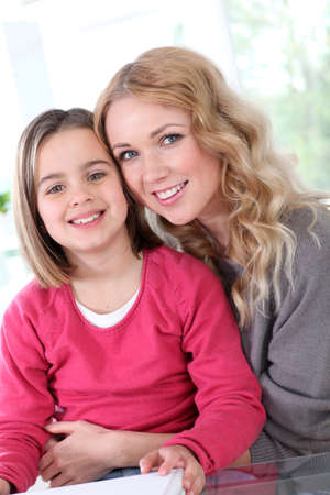 8 years: Portrait of happy mother and daughter Stock Photo