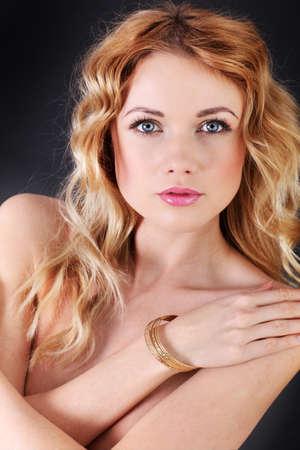 Portrait of beautiful blond woman wearing jewelry photo