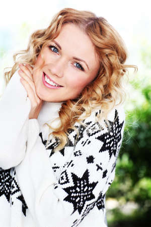 cocooning: Portrait of beautiful blond woman with wool sweater