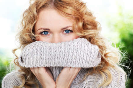 Portrait of beautiful blond woman with wool sweater photo