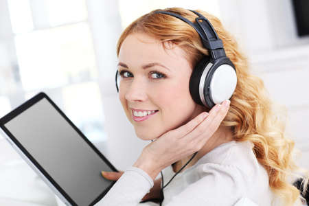 Portrait of woman with tablet and headphones photo