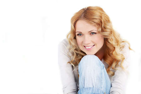Portrait of beautiful blond woman on white background photo