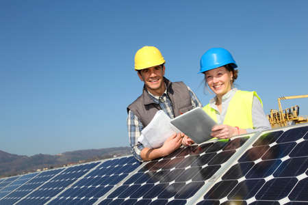 durable: Man showing solar panels technology to student girl