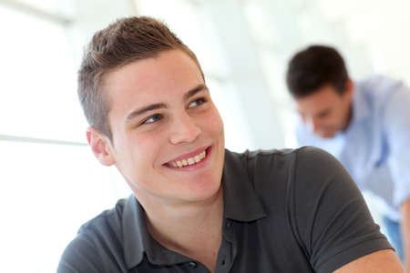 Portrait of cheerful student boy in class photo