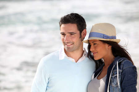 Romantic couple walking by the beach Stock Photo - 13030087