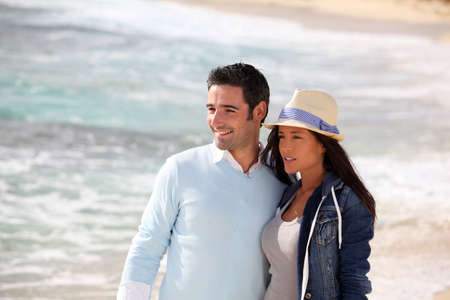 Romantic couple walking by the beach Stock Photo - 13030379
