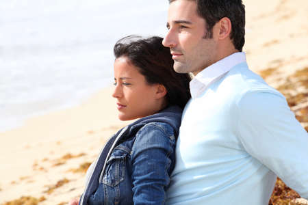 Couple relaxing on a sandy beach photo