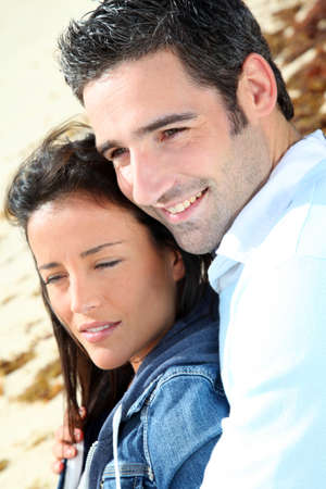 Couple relaxing on a sandy beach Stock Photo - 13030685