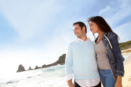 Romantic couple walking by the beach photo