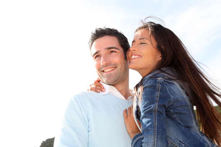 Romantic couple walking by the beach Stock Photo - 13029830