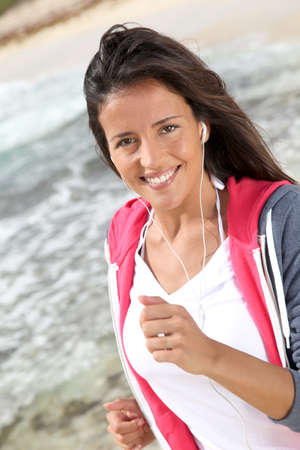 Portrait of woman doing exercises by the beach photo
