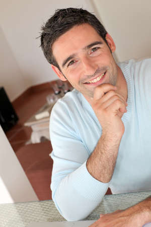 Portrait of smiling man working from home Stock Photo - 13031052