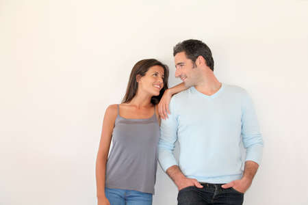 cute girlfriends: Trendy couple standing on white background Stock Photo