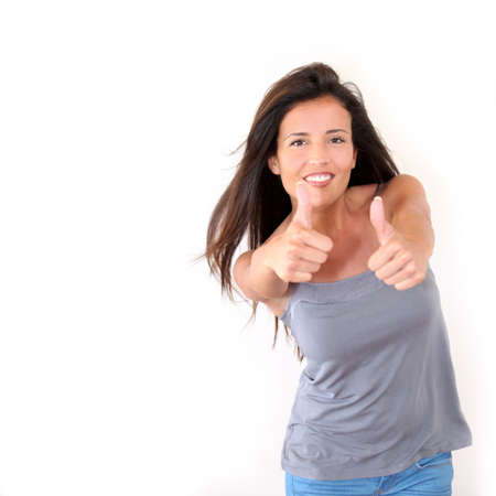Charming young woman showing thumbs up, isolated Stock Photo - 13029705