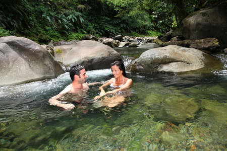 guadeloupe: Couple having a bath in fresh river water