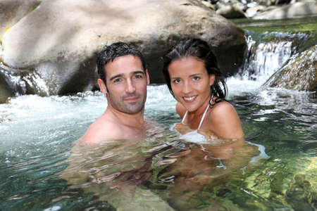 woman bathing: Closeup of cheerful couple bathing in river