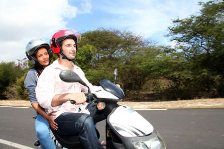Couple riding motorbike on a country road photo