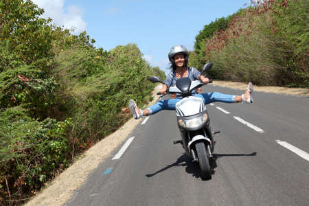 Young woman riding motorbike photo