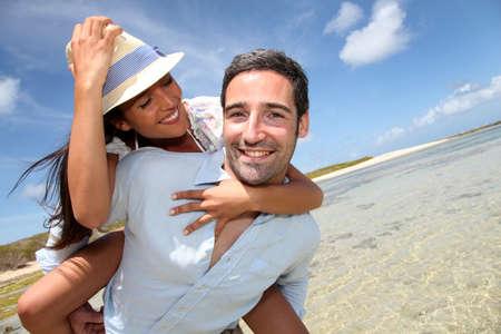Lovers enjoying sunny day at the beach  photo