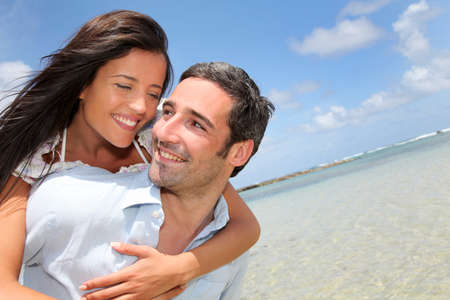 Lovers enjoying sunny day at the beach