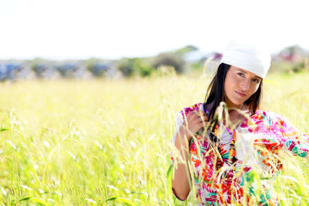 gypsie: Beautiful gypsy girl with scarf standing in meadow Stock Photo