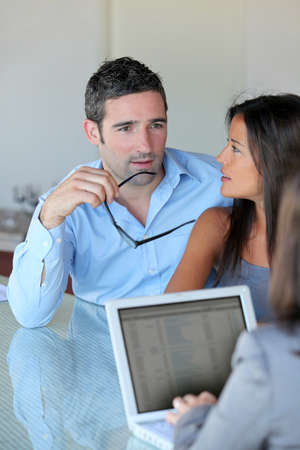contractual: Couple meeting financial adviser for investment