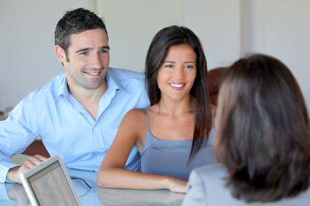satisfied: Couple meeting financial adviser for investment