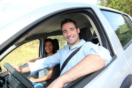 drivers: Happy couple riding car on vacation