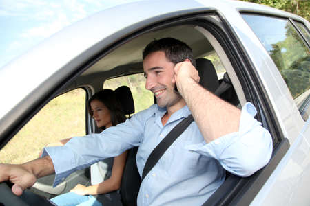 Man talking on mobilephone while driving photo